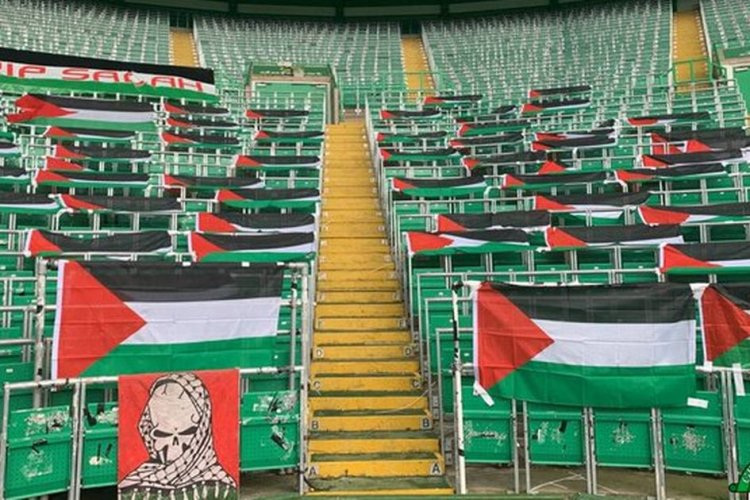 Green Brigade deck out Celtic Ultras section with Palestine flags